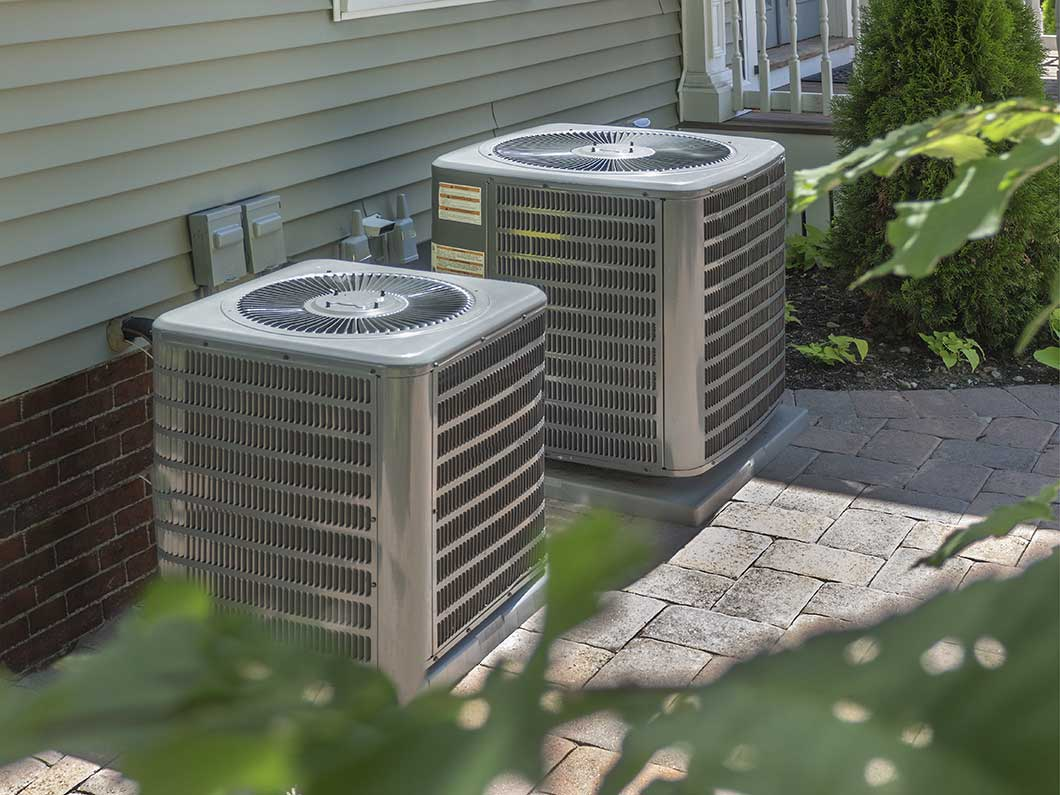 A home with an HVAC system outside in New Brighton, PA